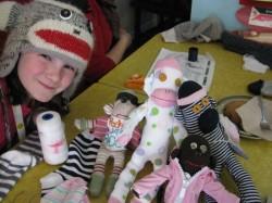 Sock Monkey Girl with her collection of sock monkeys