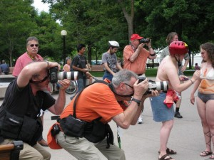 For every naked person, there was a fully-clothed photographer or two